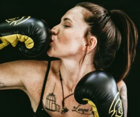 Woman kissing boxing gloves Stock Photo