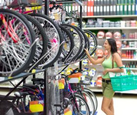 Woman looking at bicycle in Sporting goods store Stock Photo