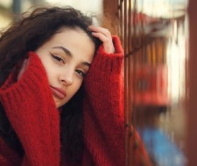 Woman outdoors wearing red sweater coats Stock Photo