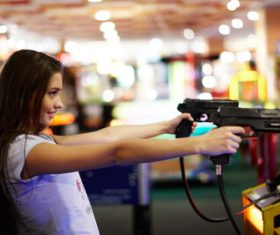 Woman playing shooting game Stock Photo