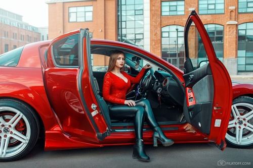 Woman sitting in the car with open door Stock Photo