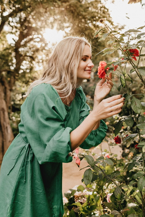 Woman smelling floral side view Stock Photo