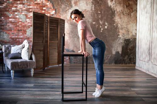 Woman standing on tiptoe indoors Stock Photo