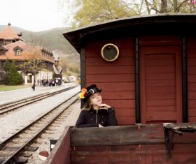 Woman standing on vintage train Stock Photo