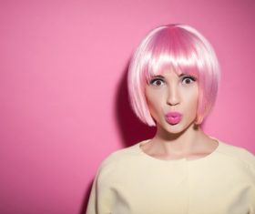 Woman wearing pink wig duck face Stock Photo