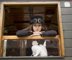 Woman with black top hat and kitten Stock Photo