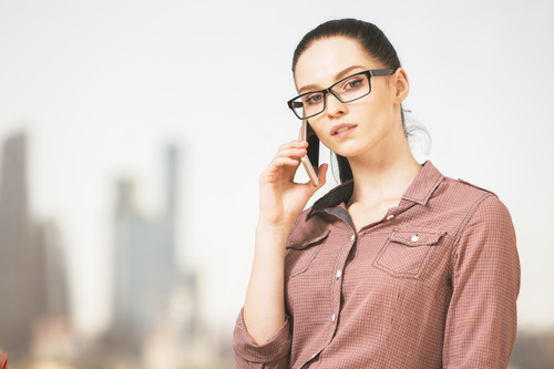 Woman with glasses taking a call Stock Photo 01
