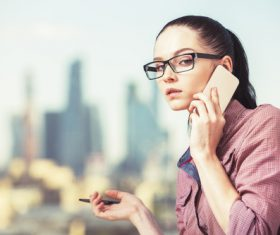 Woman with glasses taking a call Stock Photo 02