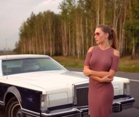 Women wear tight dress and Cadillac car Stock Photo