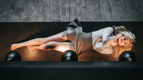 lying on back tattoo women Stock Photo