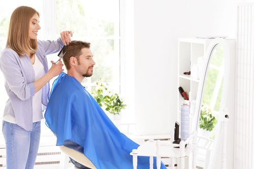 woman and man having a haircut Stock Photo 01