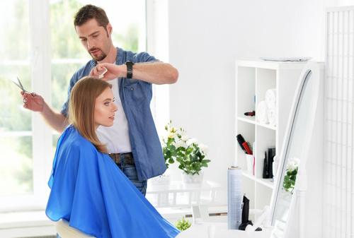 woman and man having a haircut Stock Photo 02