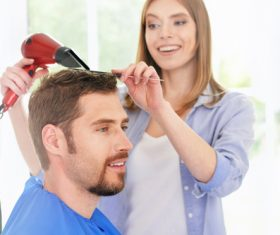woman and man having a haircut Stock Photo 03