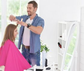 woman and man having a haircut Stock Photo 04