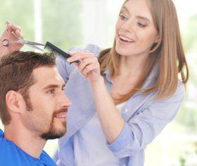 woman and man having a haircut Stock Photo 05