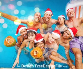 Christmas people and pool stock photo