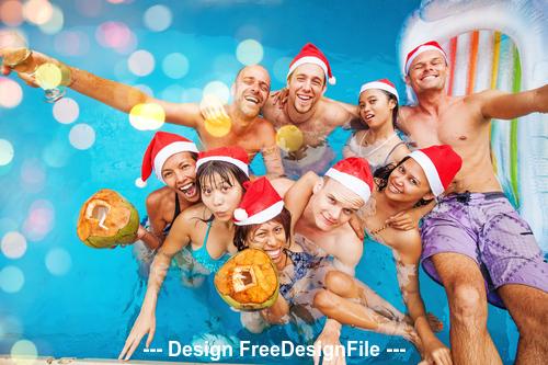 Christmas people and pool stock photo