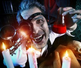 Crazy medieval scientist working Alchemist Halloween Stock Photo 04