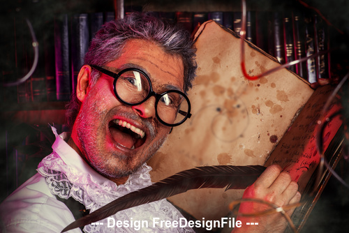Crazy medieval scientist working with old manuscripts Halloween Stock Photo