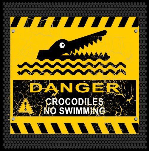 Beware of crocodile warning sign vector